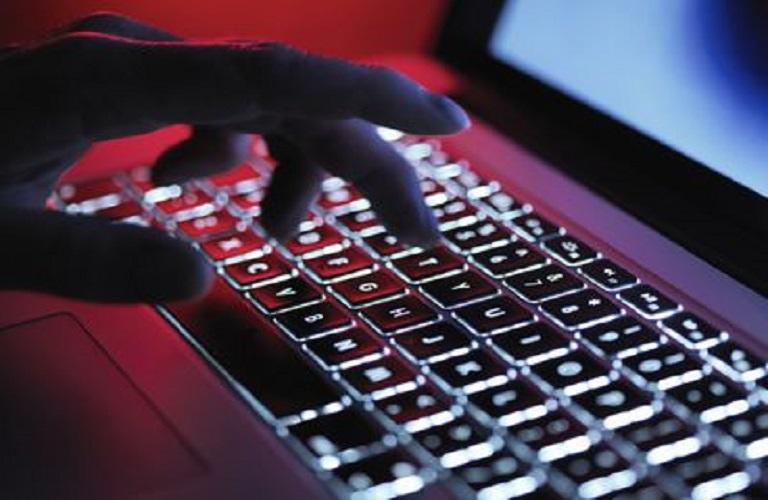 a-dark-mystery-hand-typing-on-a-laptop-computer-at-night-685007437-5b248818ba61770036e0cbf2